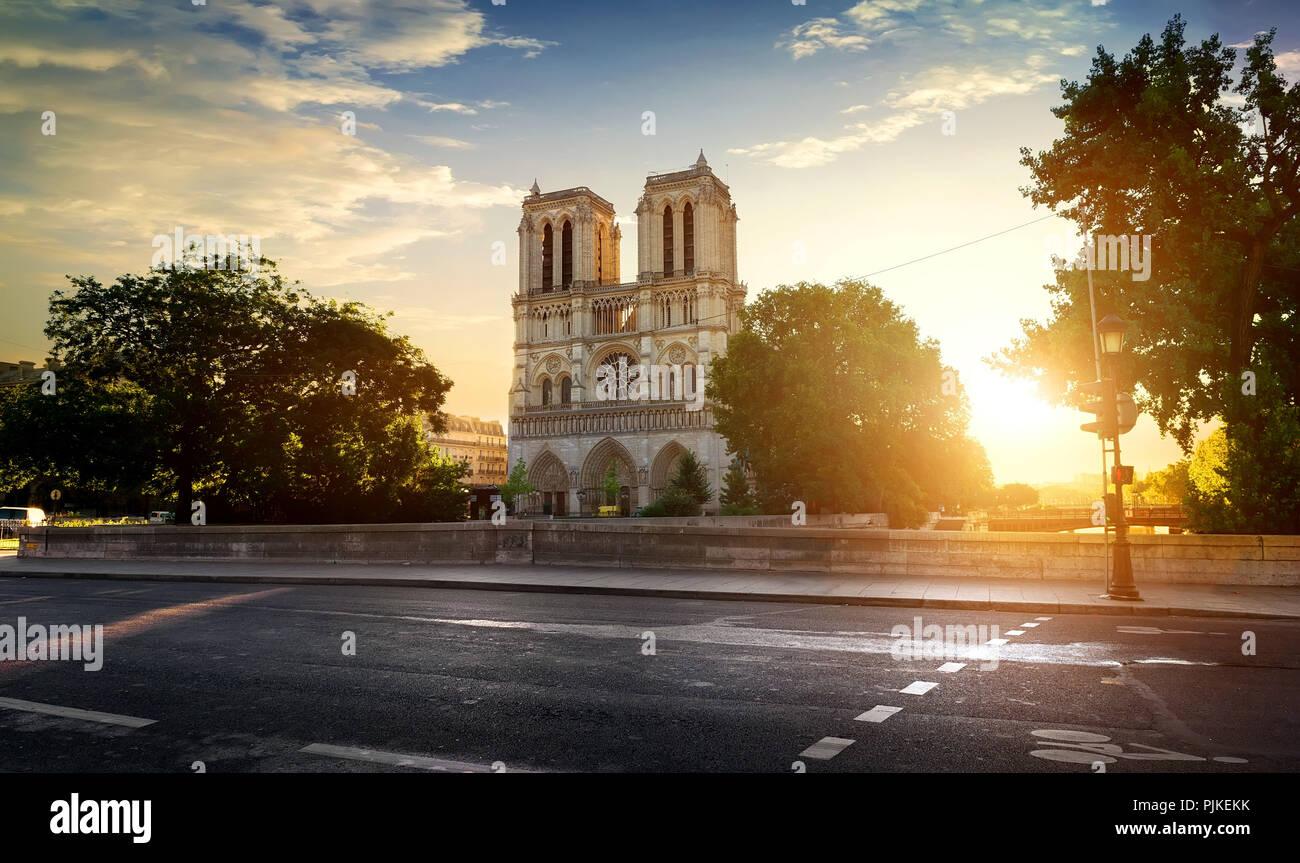 Notre Dame de Paris near road at sunset, France - Stock Image