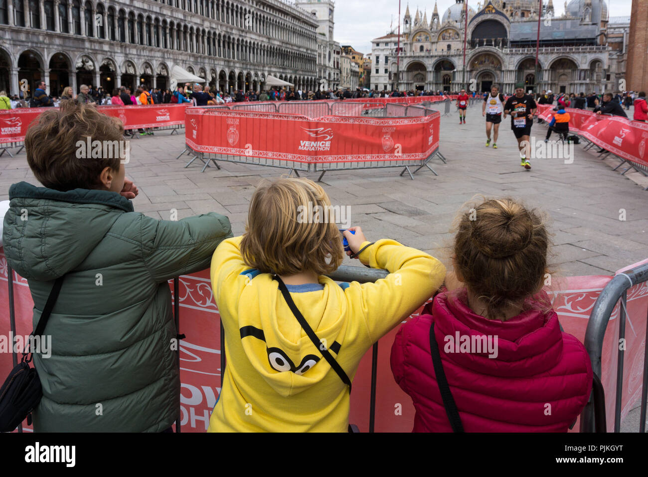 Venice, St. Mark's Square, Venice Marathon, watched by children - Stock Image