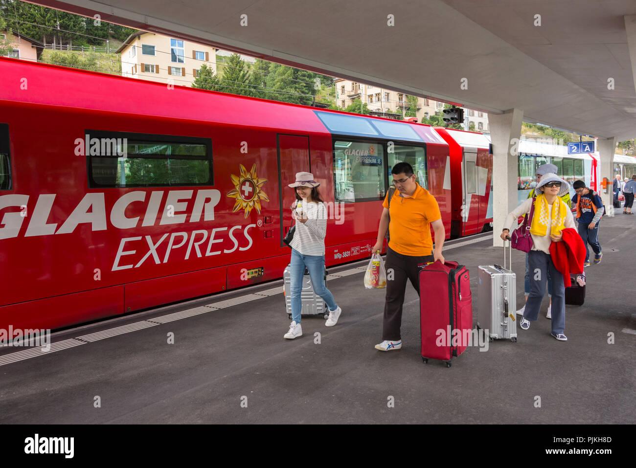 Glacier Express in the train station St. Moritz, Rhaetian Railway, Upper Engadin, Grisons, Switzerland - Stock Image