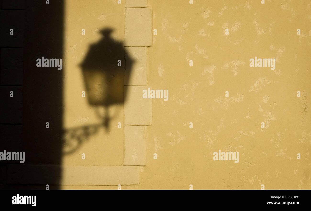Shadow of an old street lamp in Sainte-Valière - Stock Image