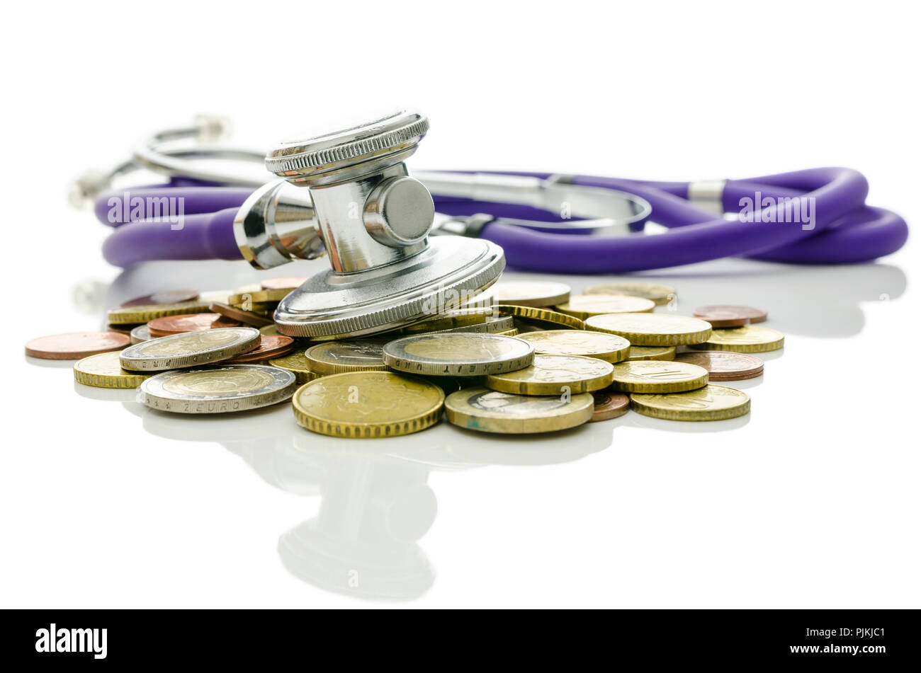 Concept of financial crisis recovery. Stethoscope on euro coins representing help and hope for the market. - Stock Image
