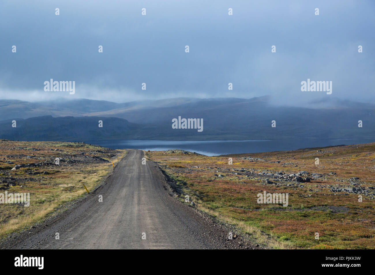 Iceland, sand road, Hrutafjord, road leading to nowhere, autumn colors, cloud atmosphere - Stock Image