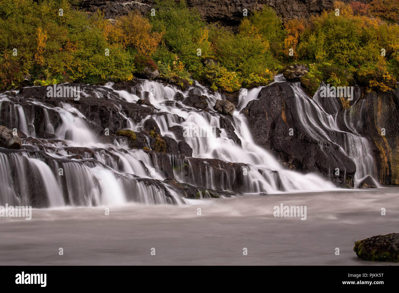 Iceland, Barnafoss, West Iceland, autumn colors, long exposure, rising from a crevice - Stock Image