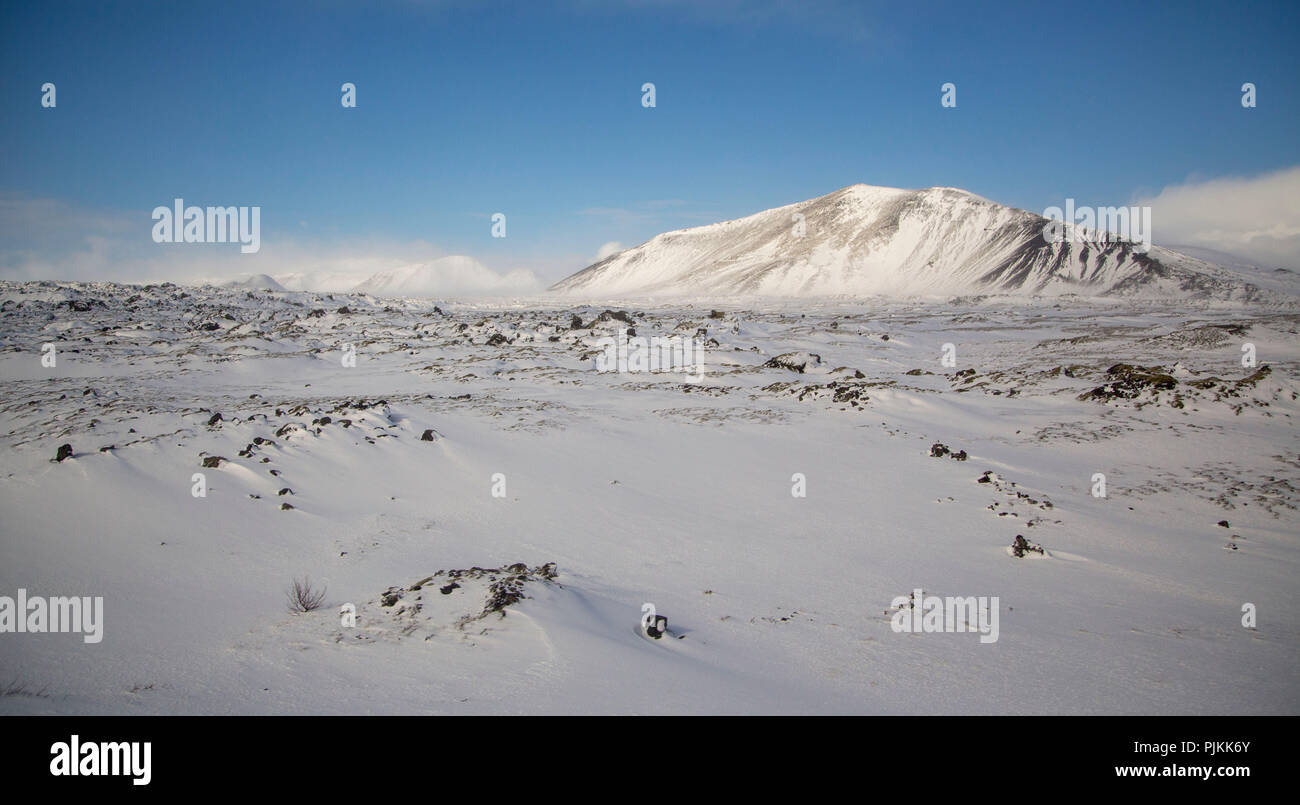 Iceland, winter landscape on the Reykjanes peninsula, snowdrift, blue sky - Stock Image