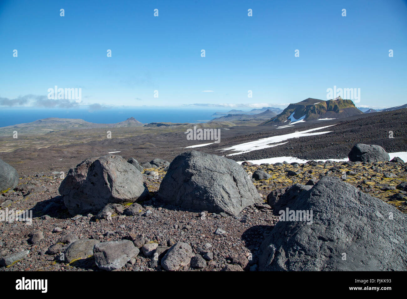 Northern slopes of the Snaefellsjökull, lava field, Breidafjord in the background, blue sky over blue sea, extreme vastness - Stock Image