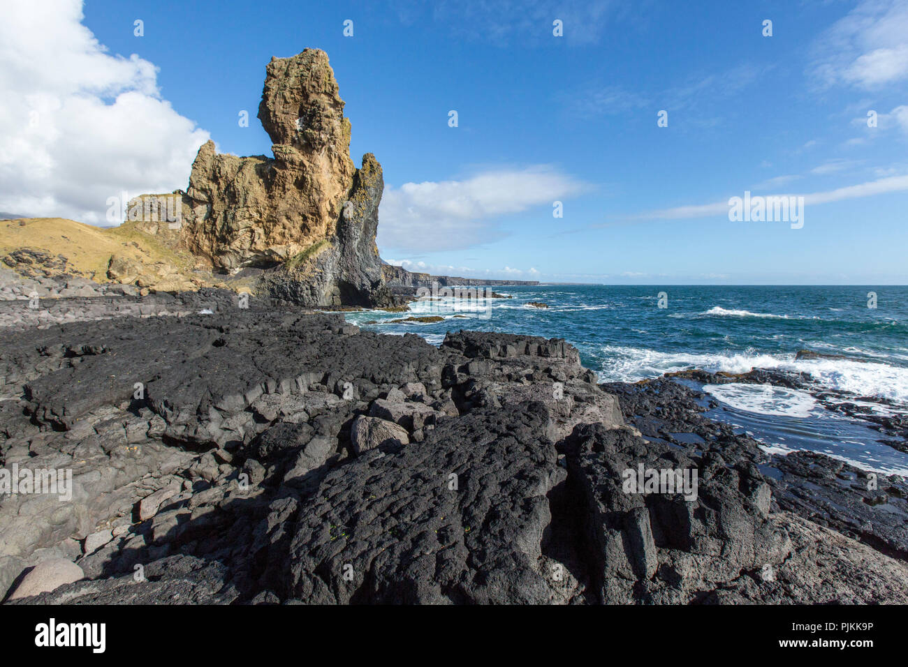 Iceland, Snaefellsnes, Cliffs of Londrangar, lava beach, volcano vent, blue sky - Stock Image