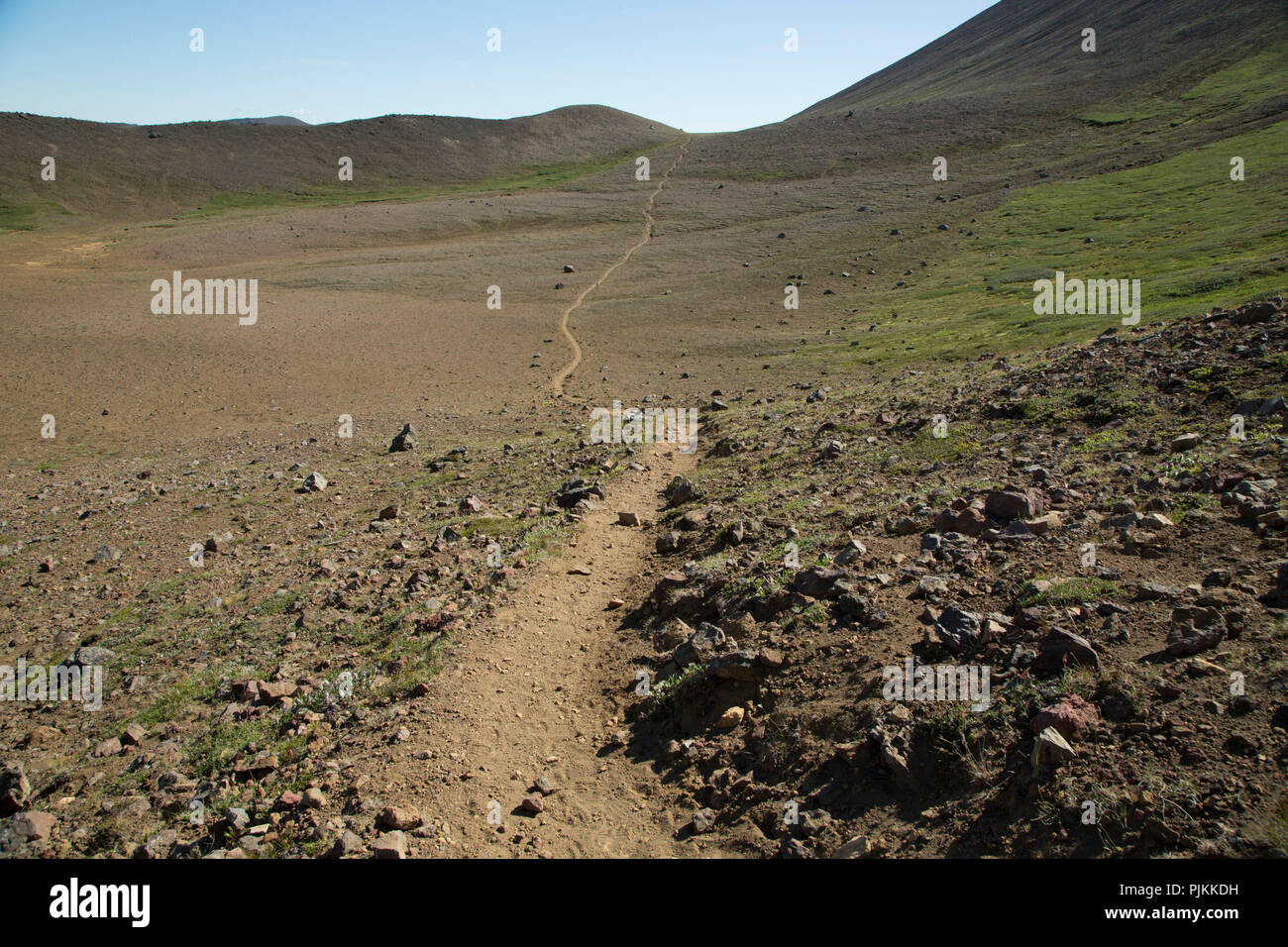 Iceland, long empty hiking trail in volcanic desert, deserted to the horizon, nice weather - Stock Image