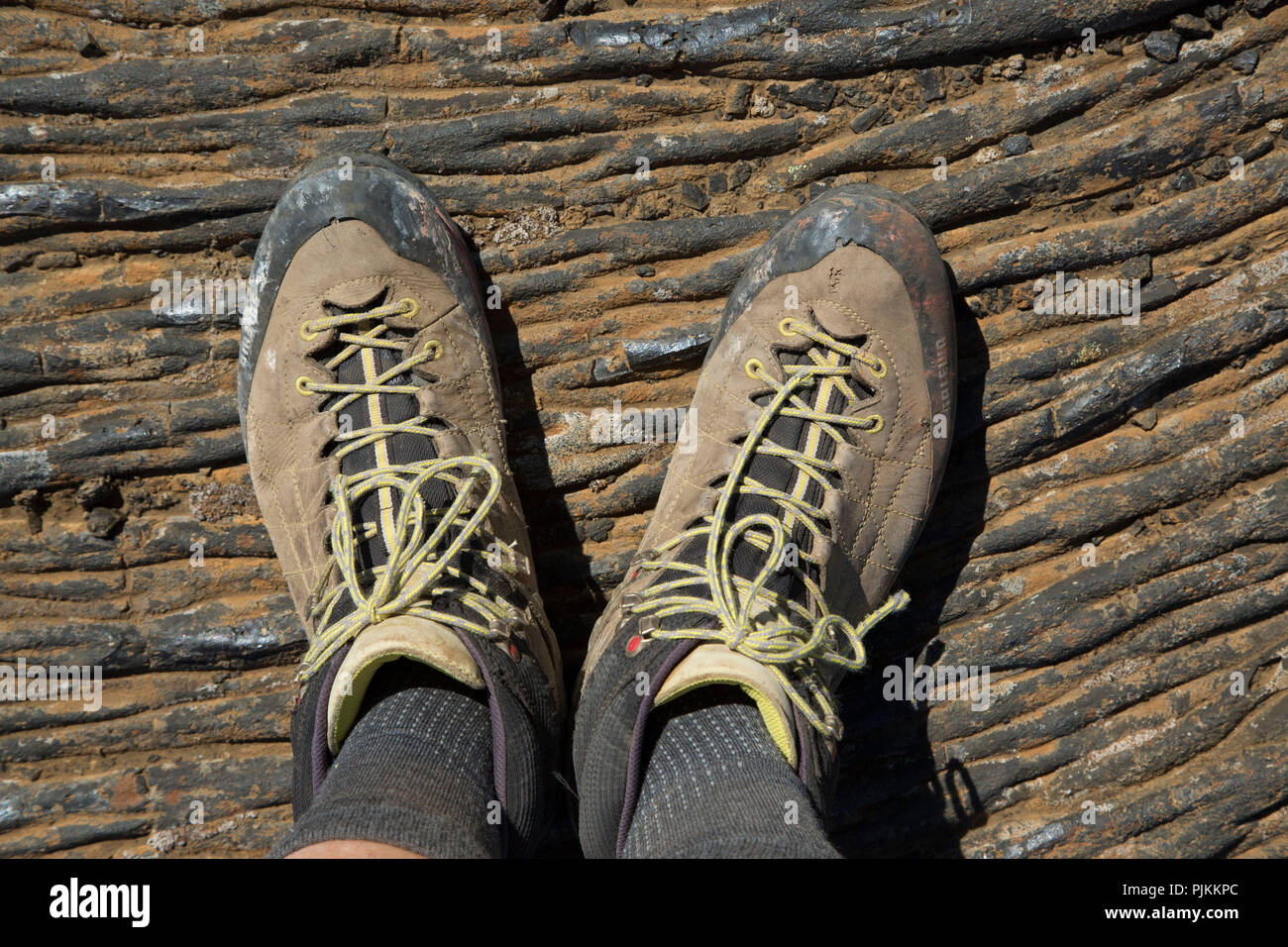 Iceland, hiking boots on cooled lava - Stock Image
