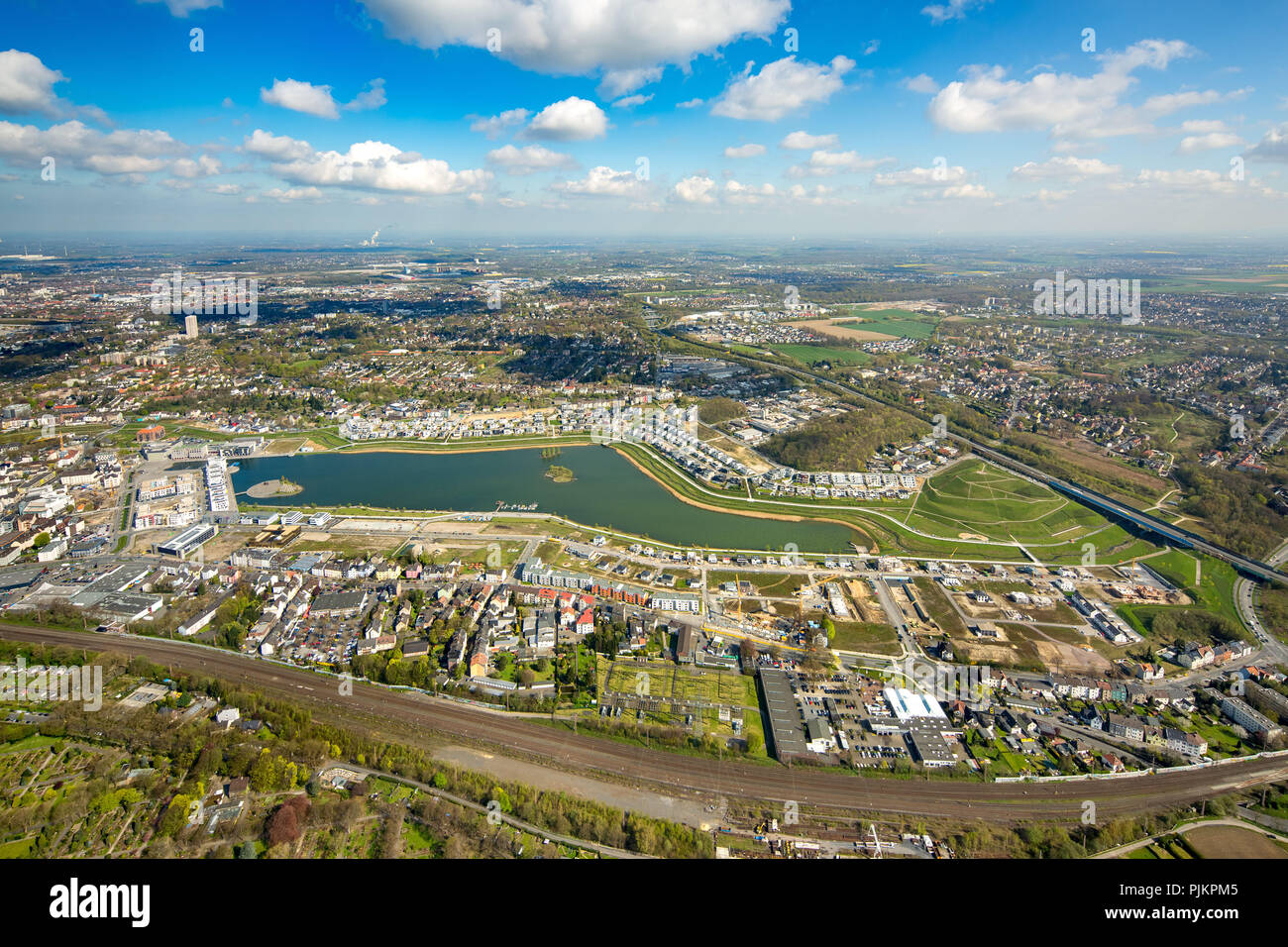 Phoenix Lake is an artificial lake on the former steelworks Phoenix East in Dortmund district Hörde, recreational area, residential area, rainwater retention basin, Dortmund, Ruhr, North Rhine-Westphalia, Germany Stock Photo