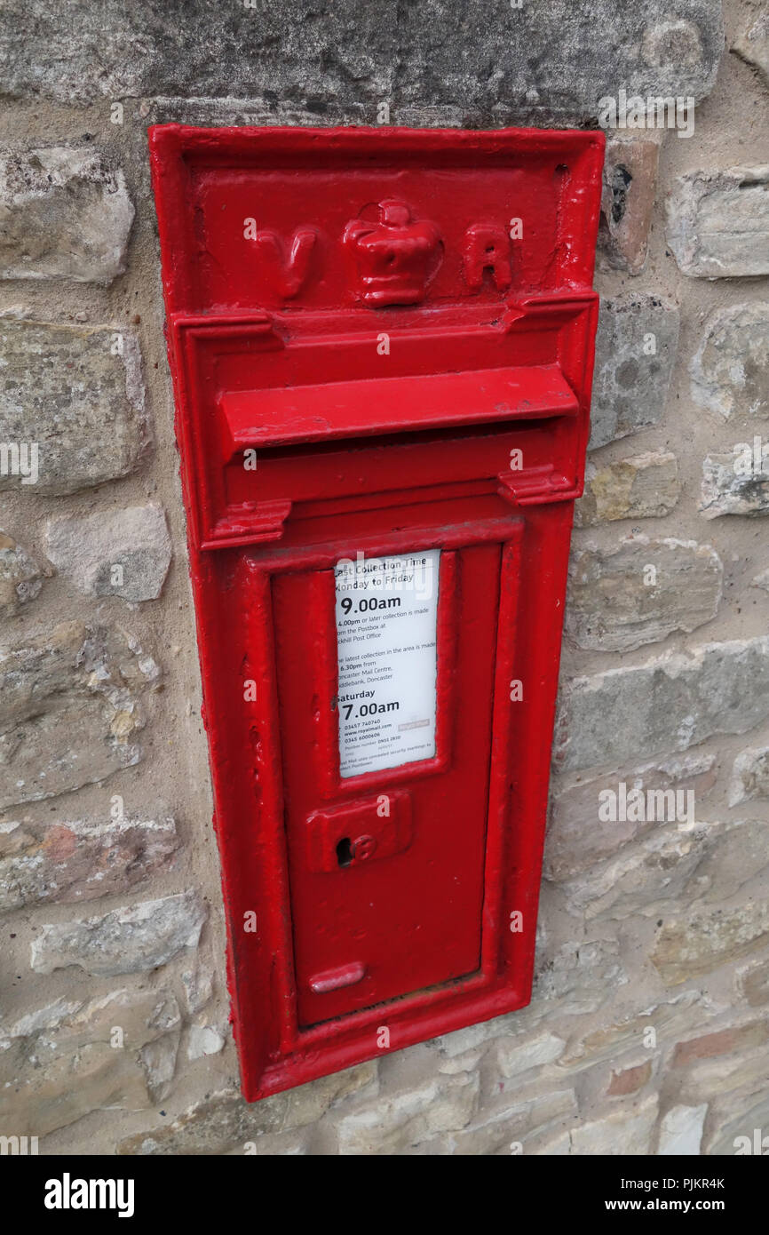 Letter box built into stone wall - Stock Image
