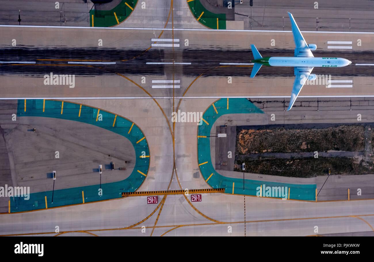 LAX, Los Angeles International Airport, Runway, Jet taking off, Los Angeles, Los Angeles County, California, USA Stock Photo