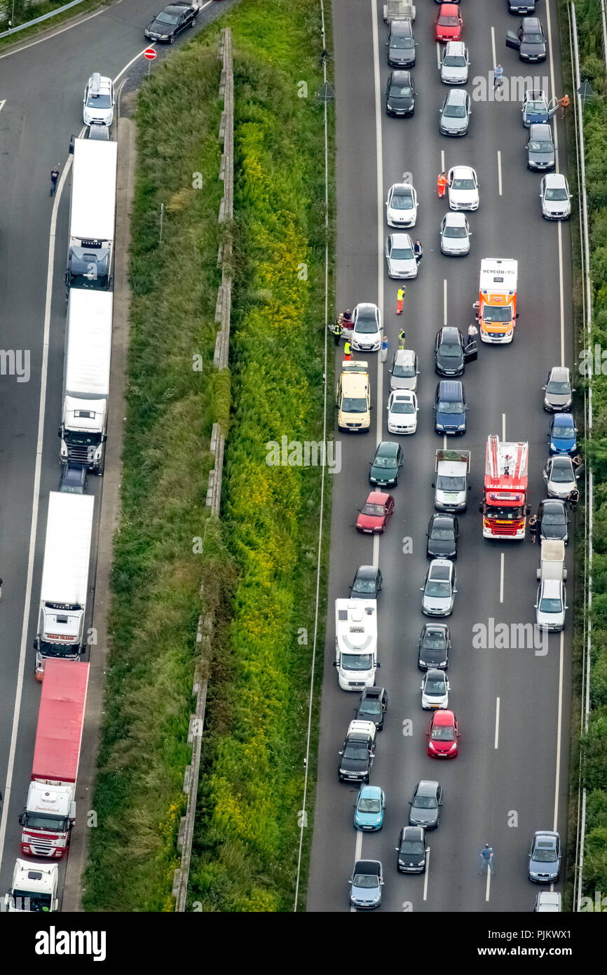 Highway A2 rescue lane, fire department use, RTW with first aid for a motorist, traffic jam, highway congestion on the A2, Gelsenkirchen, Ruhr area, North Rhine-Westphalia, Germany - Stock Image