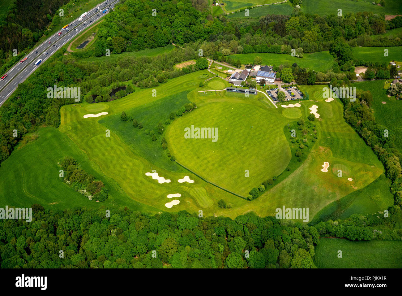 Golfclub Gut Berge Gevelsberg with driving range, bunker and clubhouse, parking lots, Gevelsberg, Ruhr area, North Rhine-Westphalia, Germany - Stock Image