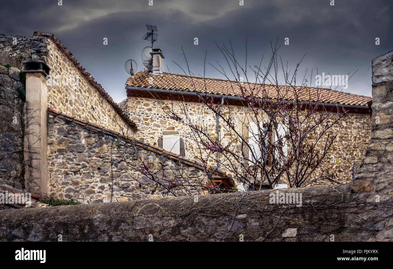 Stonewalls before storm in the village of Bize Minervois, - Stock Image