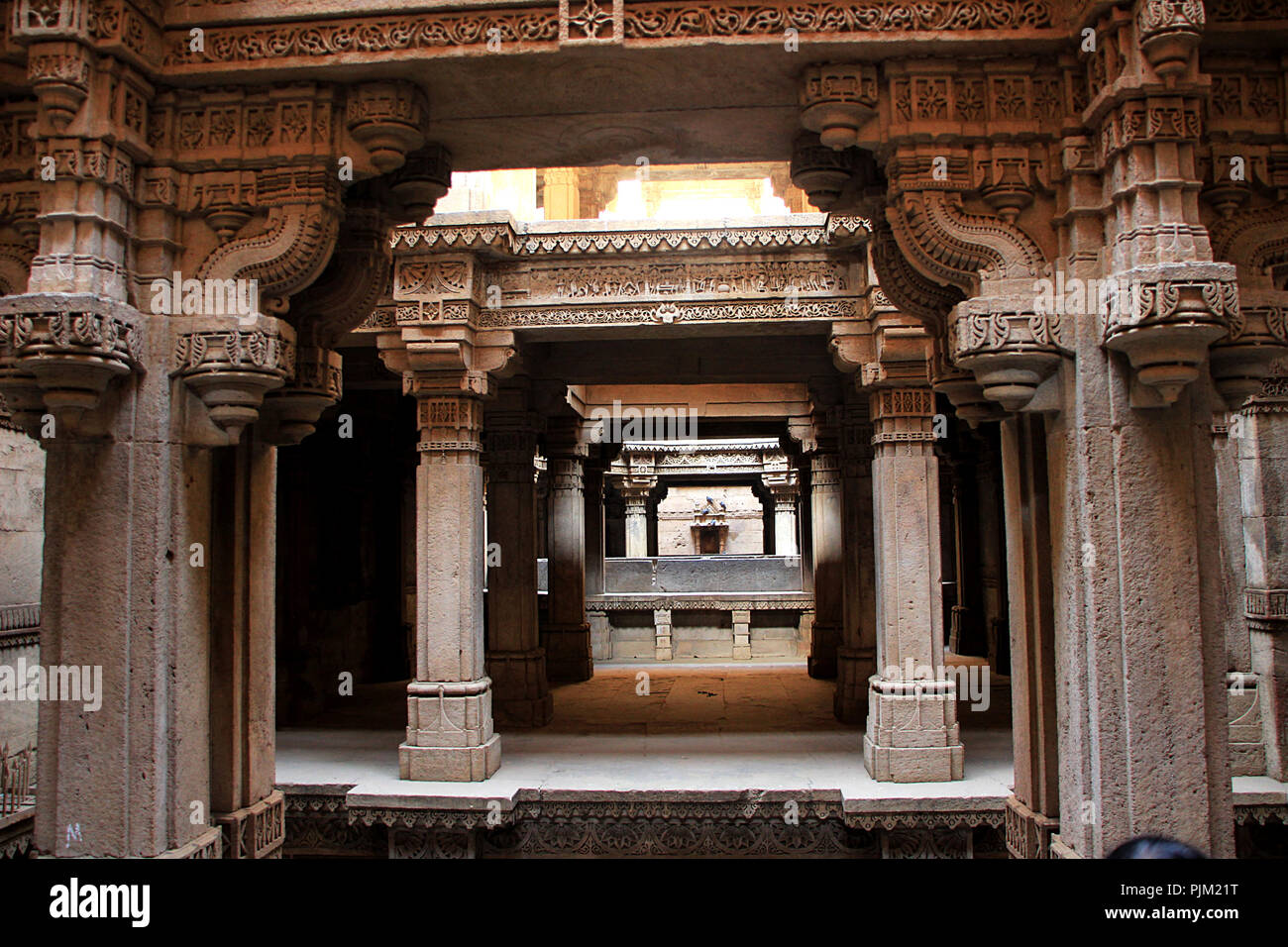 Perspective close up of stone pillared canopy over Adalaj Step Well at Ahmedabad, Gujarath, India, Asia - Stock Image