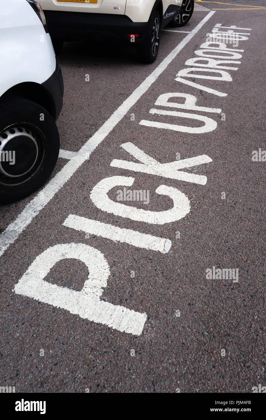 Pick up - drop off wording written on a road surface in the car park in Doncaster - Stock Image