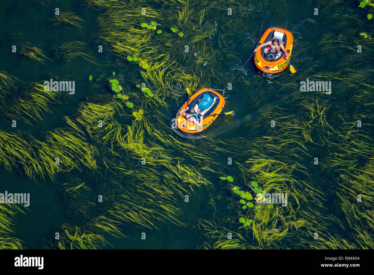 Bochum, rubber boats and air mattresses on the Ruhr at Kemnade reservoir, Witten, Ruhr area, North Rhine-Westphalia, Germany - Stock Image
