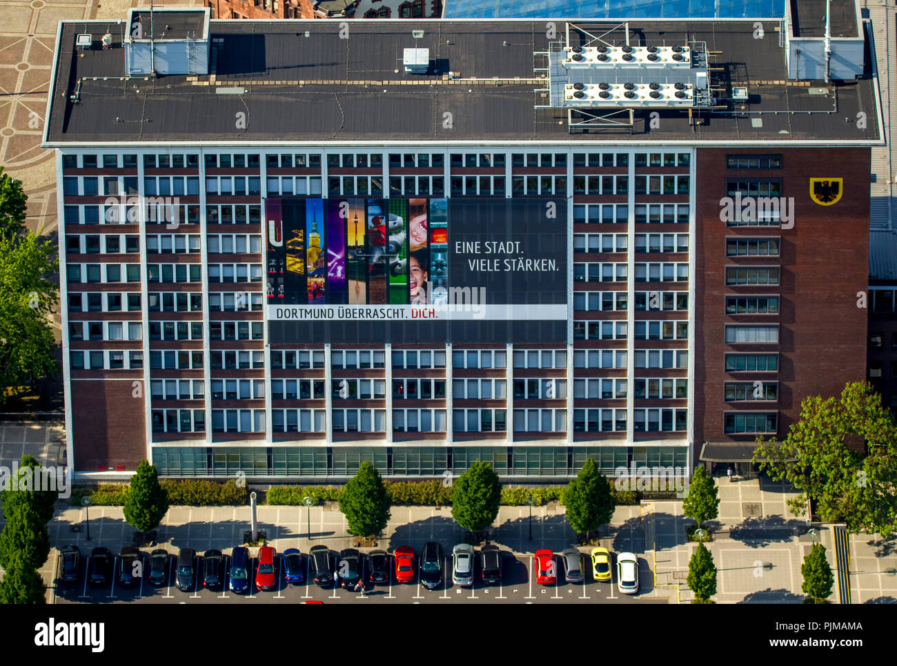 Poster 'One city - many strengths' Dortmund surprises you, city administration Office for Housing and Urban Renewal, Dortmund, Ruhr Area, North Rhine-Westphalia, Germany - Stock Image