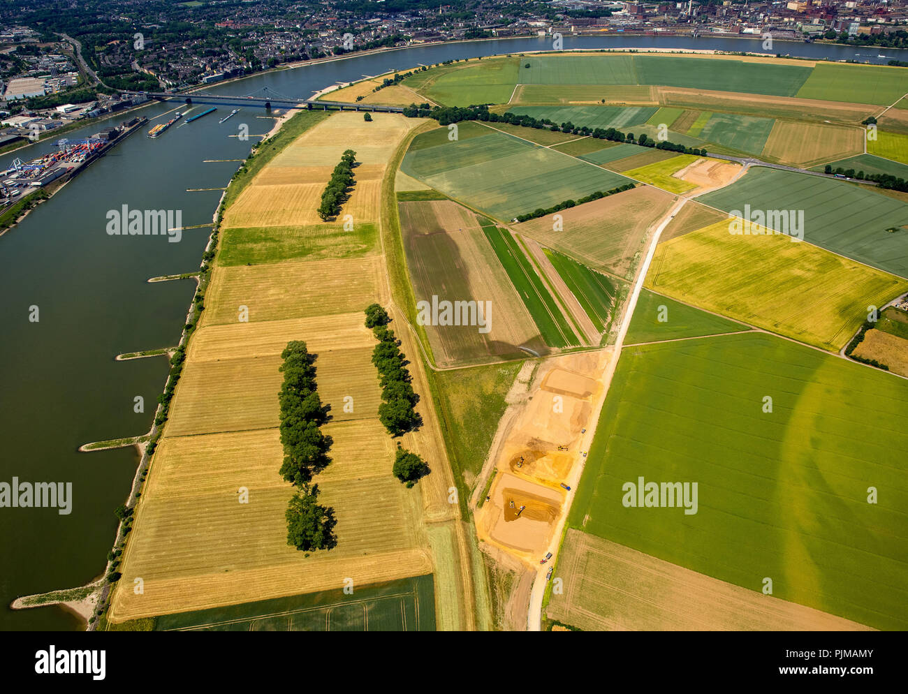 Flood protection by a new Rhine dike in the south of Duisburg, Rheindeich near Mündelheim and opposite Krefeld-Uerdingen at the bridge of the federal highway 288, fields, agriculture, Duisburg, Rhine view, Ruhr area, North Rhine-Westphalia, Germany Stock Photo
