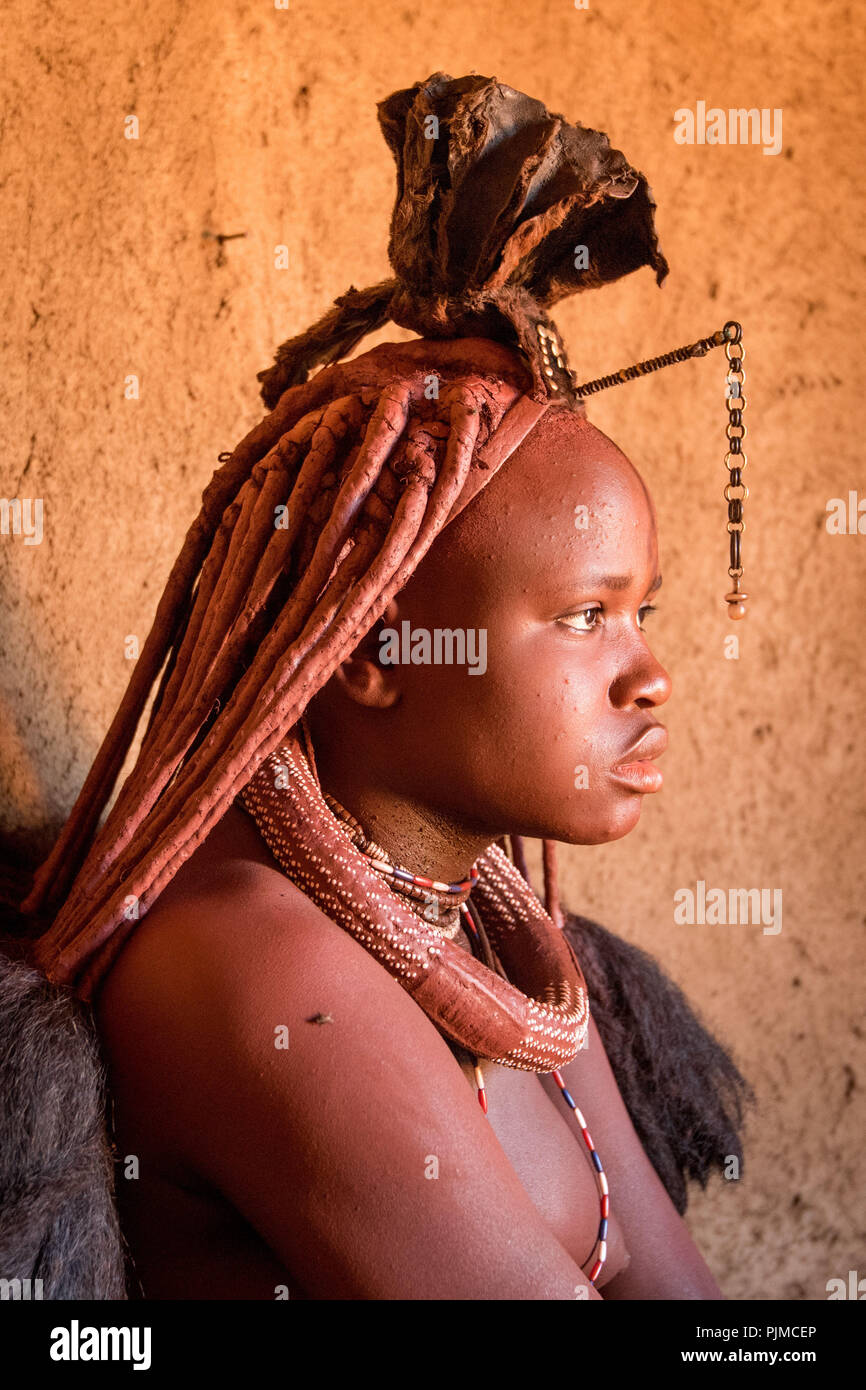 Portrait of a Himba woman with traditional headgear, side profile - Stock Image
