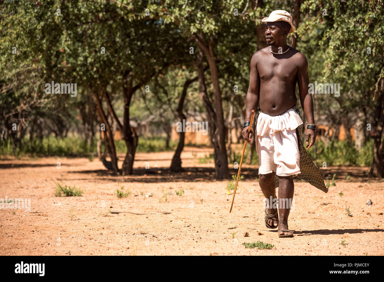 A Himba man was away with the cattle herds and returned to the village - Stock Image