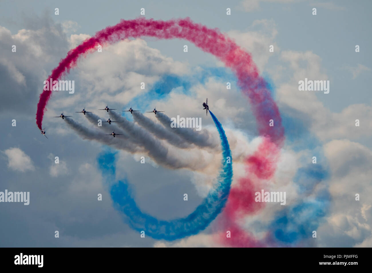 The RAF Red Arrows perform the Tornado manoeuvre during their afternoon display at Dunsfold Wings & Wheels, UK on the 25th August 2018. - Stock Image