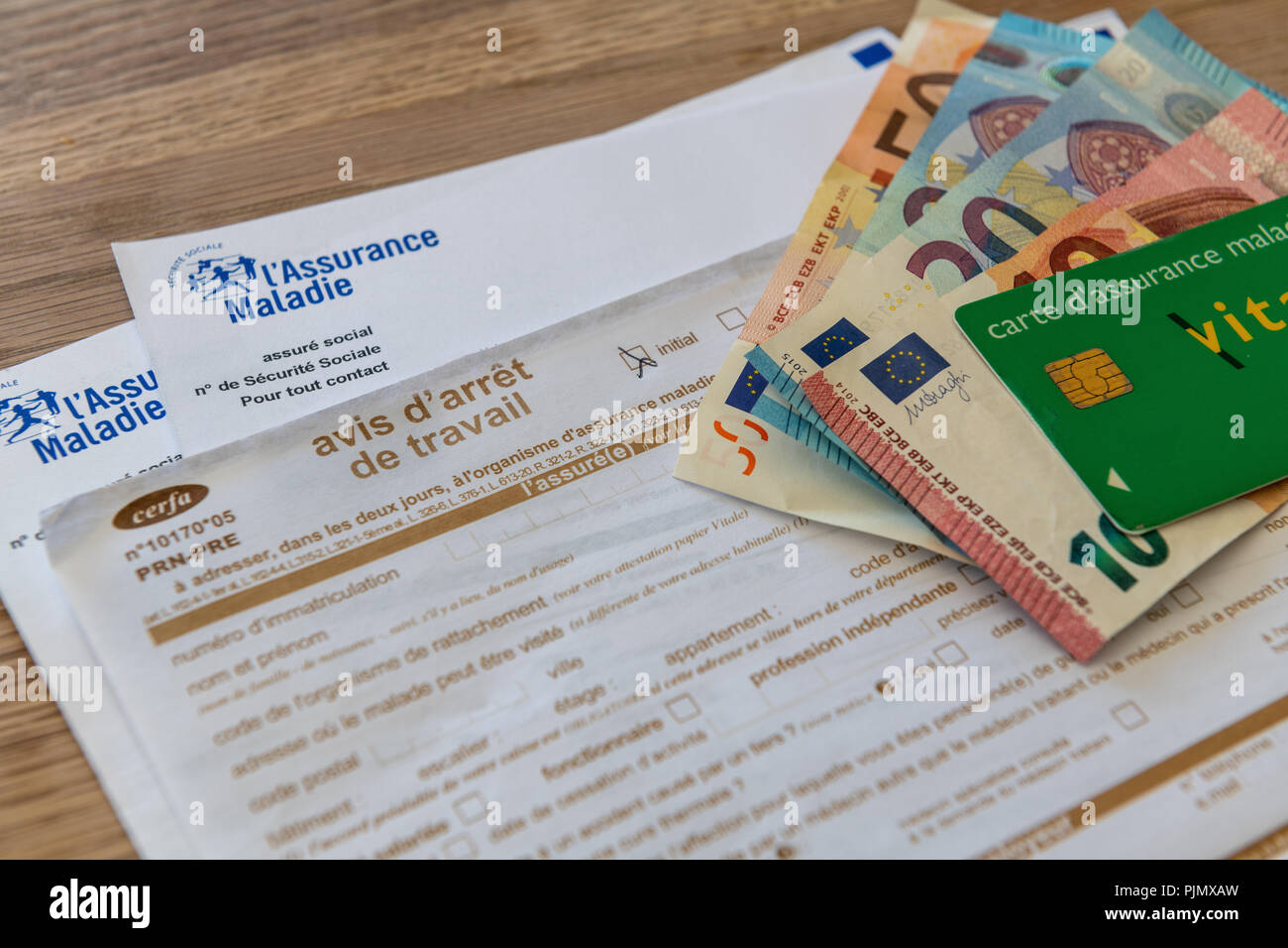 document pour carte vitale French document of sick leave, stoppage of work, with money and