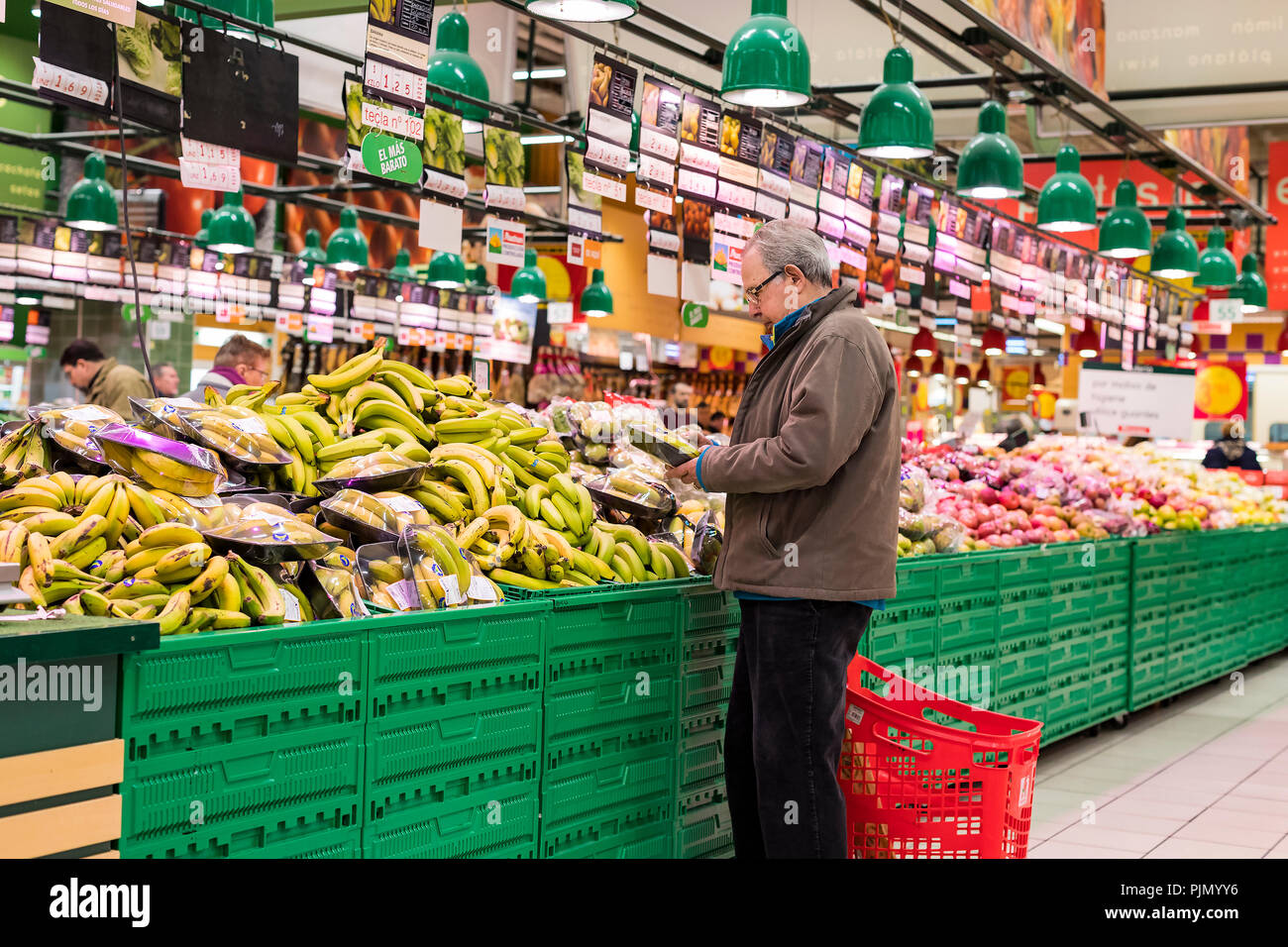 MADRID, SPAIN - 26 MARCH, 2018: Large food supermarket with customers and products and staff. Stock Photo