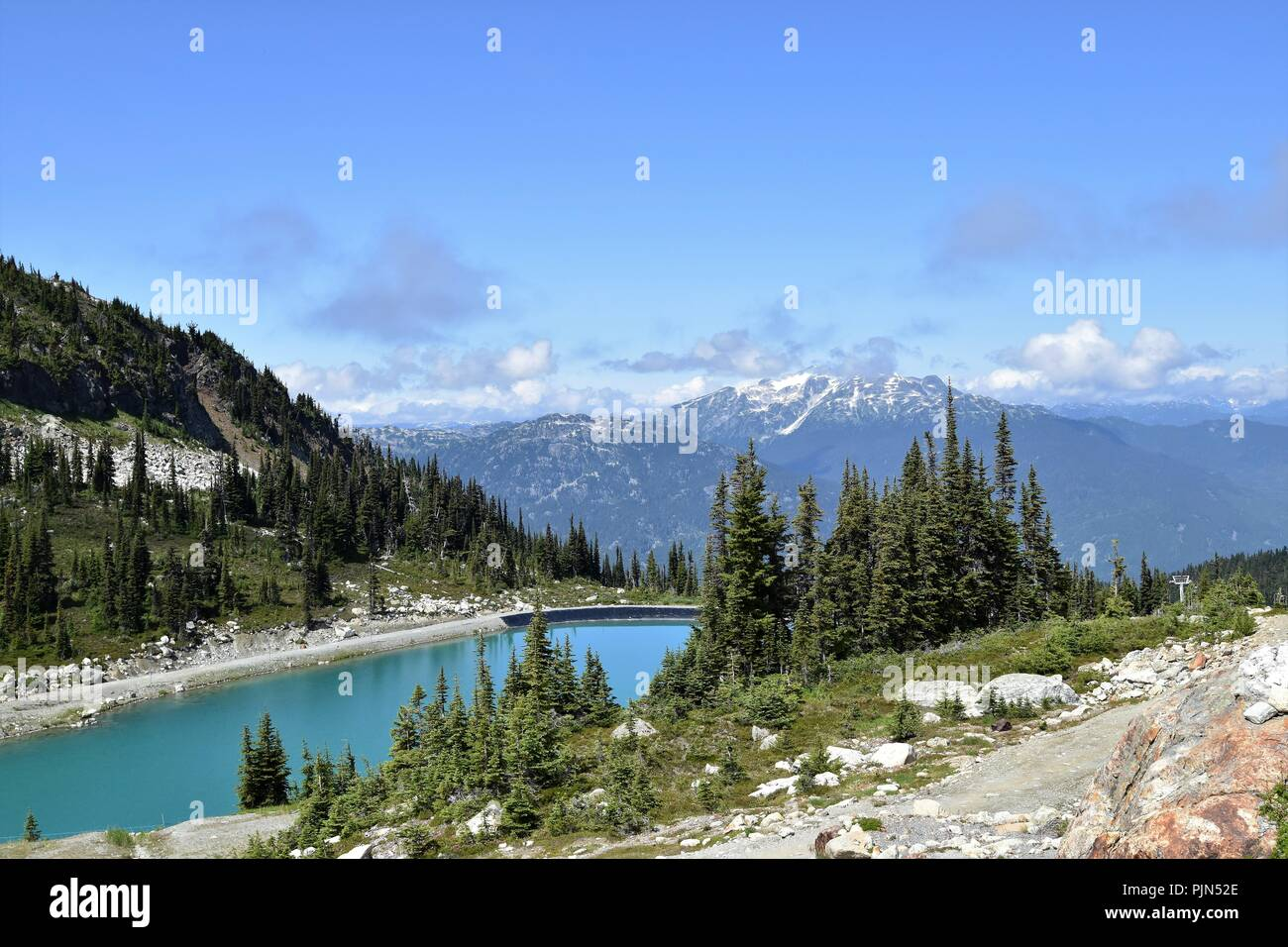 Above the clouds, in Whistler mountains, British Columbia, Canada. - Stock Image