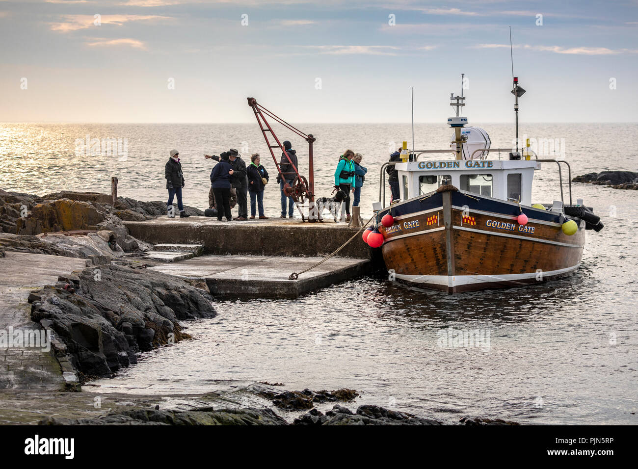 Day trippers on a boat tour of the Farne Islands, Northumberland, England. Stock Photo