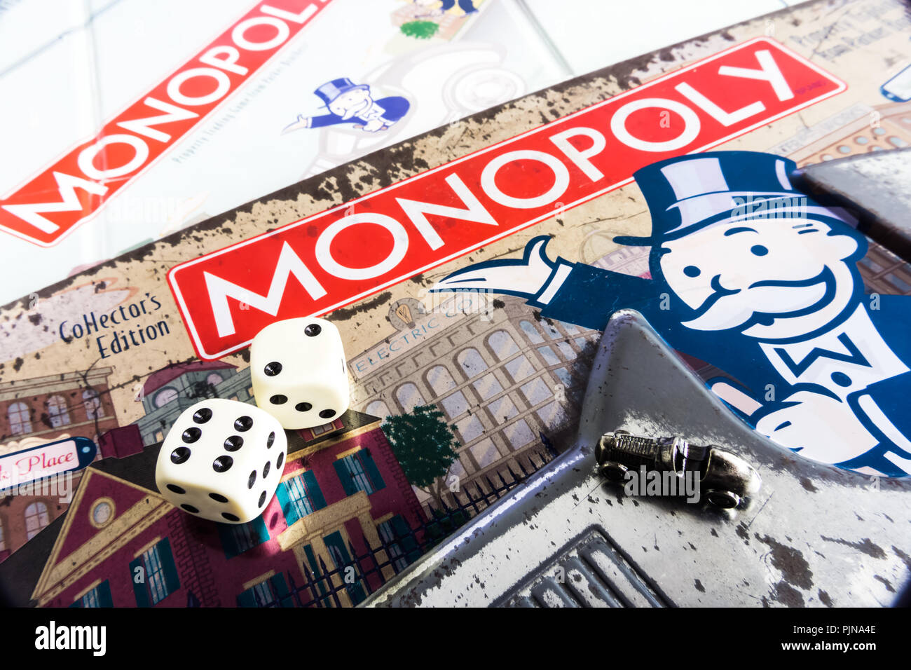 Monopoly Board Game close up with the box, board and dices. The classic real estate trading game from Parker Brothers Stock Photo