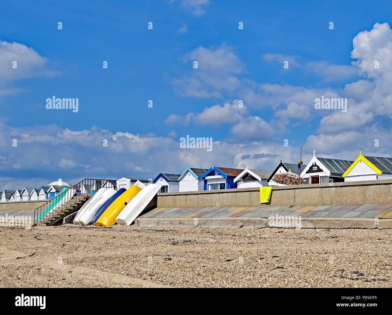 Taken to capture the pretty pastel shades of the contemporary beach huts on South End on Sea, Essex, England. - Stock Image