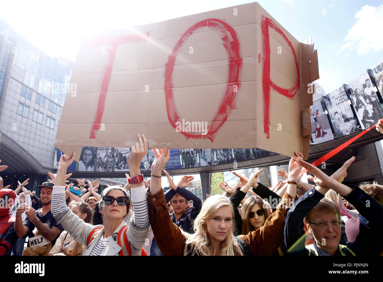 Brussels, Belgium. 8th Sep. 2018.Activists hold placards and chant slogans during a demonstration to demand immediate an action on climate change in front of European Parliament. Alexandros Michailidis/Alamy Live News Stock Photo