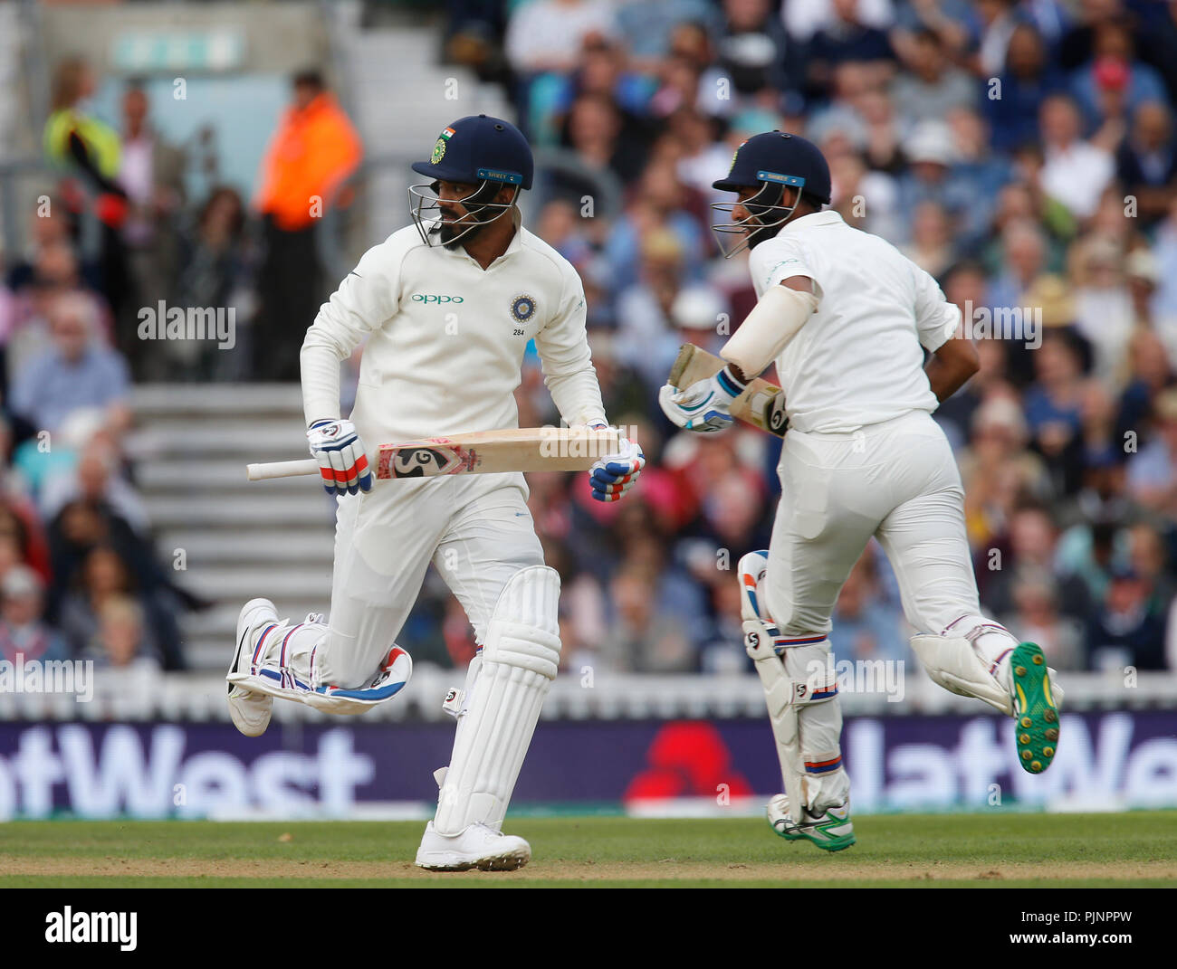 Kia Oval, London, UK. 8th Sep, 2018. Specsavers International Test Match Cricket, 5th test, day 2; KL Rahul and Cheteshwar Pujara of India run between the wickets Credit: Action Plus Sports/Alamy Live News - Stock Image