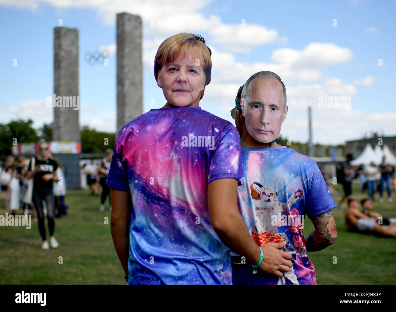 Berlin, Germany. 08th Sep, 2018. Visitors with masks by Merkel and Putin at the two-day music festival Lollapalooza on the grounds of the Olympic Park. Credit: Britta Pedersen/dpa/Alamy Live News - Stock Image