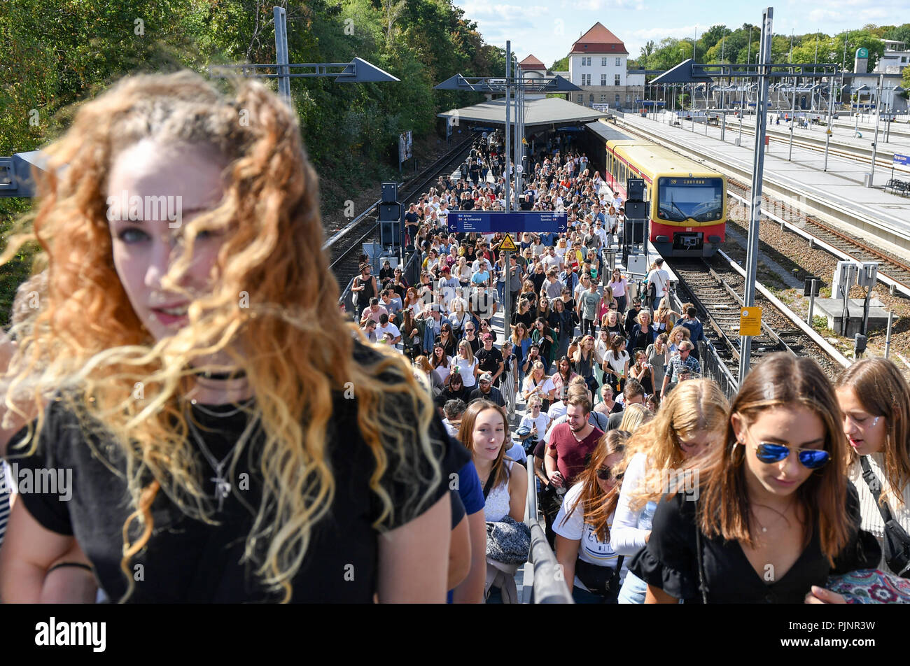 Berlin, Germany. 08th Sep, 2018. Numerous visitors come to the two-day music festival Lollapalooza to the grounds of the Olympic Park by S-Bahn. Credit: Jens Kalaene/dpa-Zentralbild/dpa/Alamy Live News - Stock Image