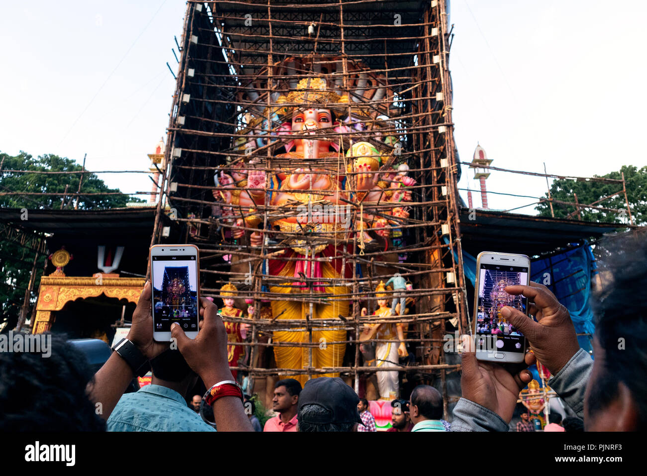 Hyderabad,India. 08th September,2018.People take photographs of 57 feet tall idol of Lord Ganesh popularly known as Khairatabad Ganesh in southern city of Hyderabad, ahead of Ganesh Chaturthi festival which begins on September 13,2018.  Ganesh Chaturthi is a 10-day Hindu festival celebrated throughout India marking the birth of the elephant-headed god Lord Ganesha, the god of prosperity and wisdom.Credit:Sanjay Borra/Alamy Live News. Stock Photo