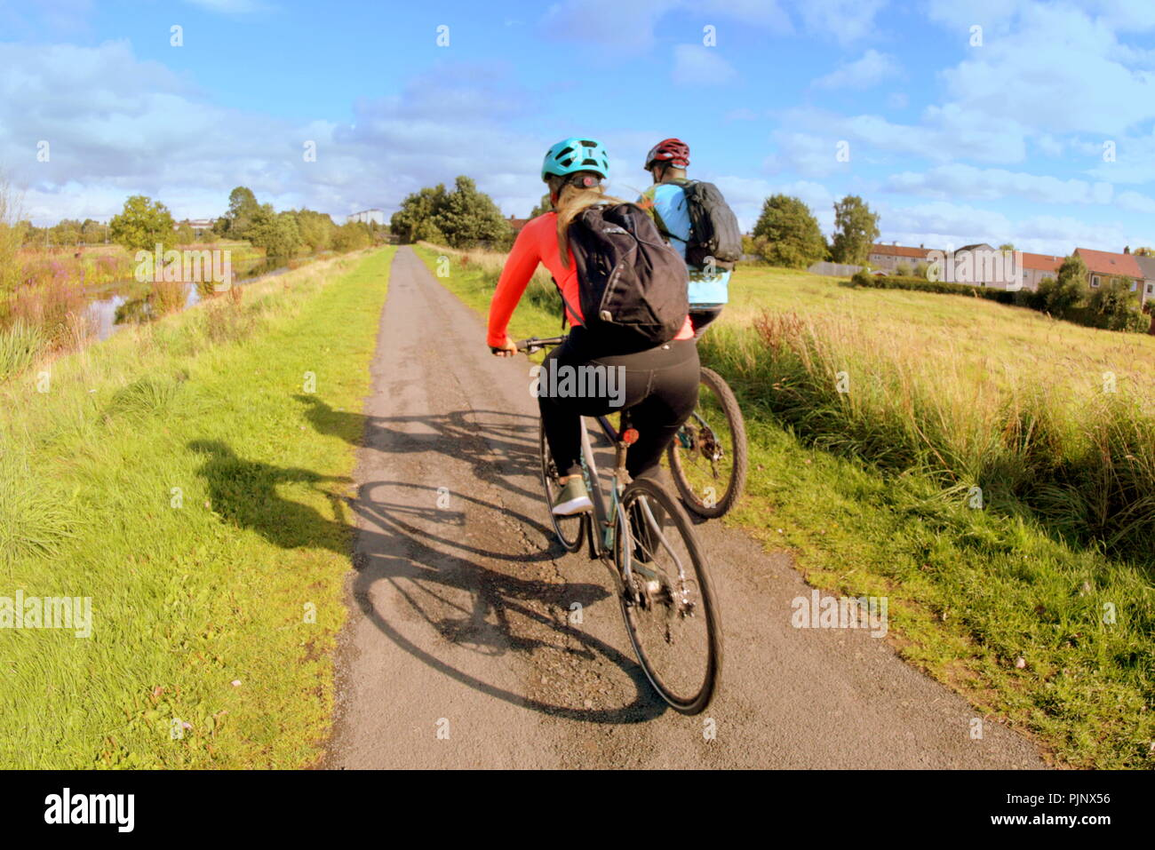 Glasgow, Scotland, UK. 8ht September, 2018. UK Weather: Sunny weather appears on the Forth and Clyde canal at the bike sculpture on national cycle route NCR 754 near Clydebank. Gerard Ferry/Alamy news - Stock Image