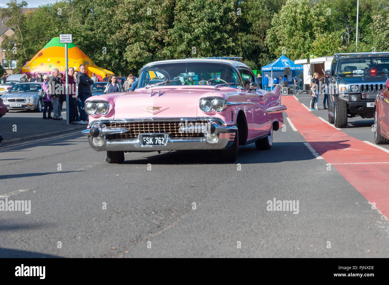 Glasgow, Scotland, UK. 8th September, 2018. Pink Cadillac on display at Giffnock Village Classic Car Show which returns for the event's fifth year. On show are a range of classic, vintage and unique cars as well as fun and entertainment for all the family. Credit: Skully/Alamy Live News Stock Photo