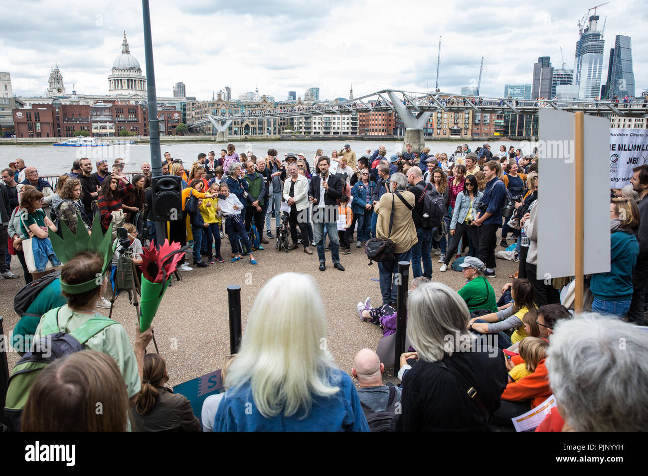 London, UK. 8th Sep, 2018. Environmental campaigners hold a rally outside Tate Modern in support of Rise For Climate, a global day of action involving hundreds of rallies in cities and towns around the world to highlight climate change and call on local leaders to commit to helping the world reach the goals of the Paris Climate Agreement. Credit: Mark Kerrison/Alamy Live News - Stock Image