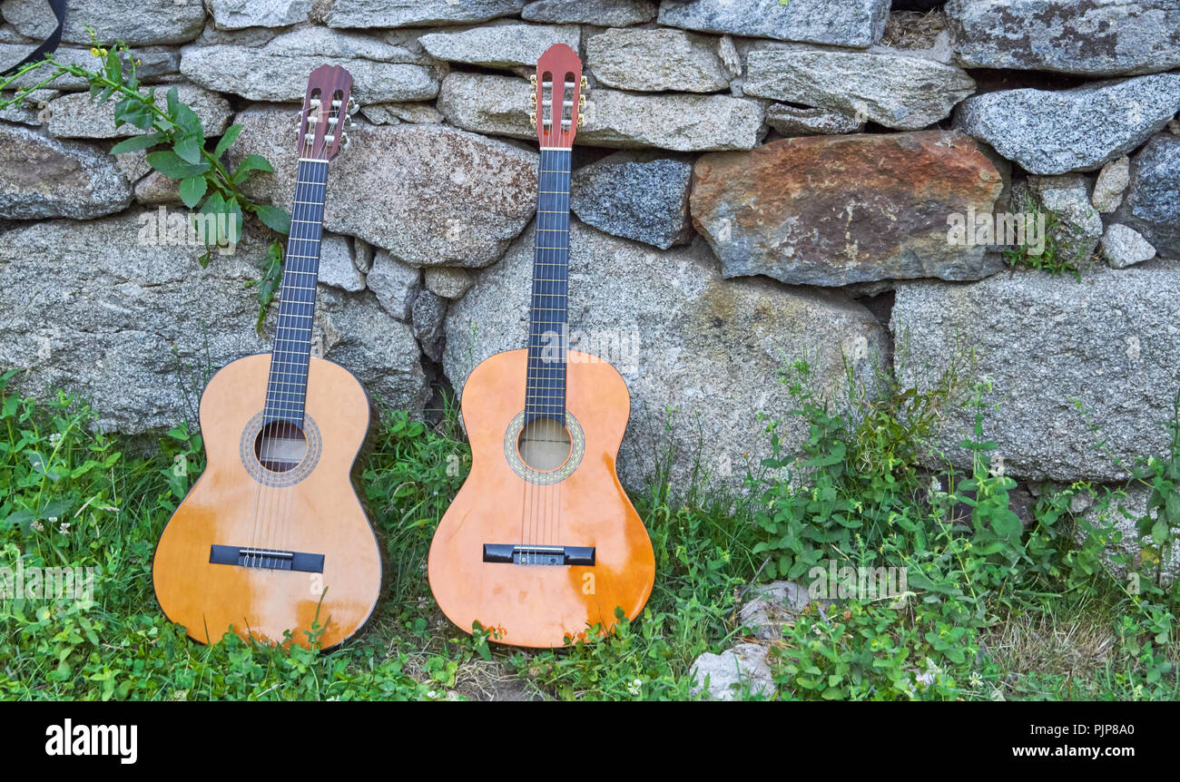 two spanish guitars in the gound - Stock Image