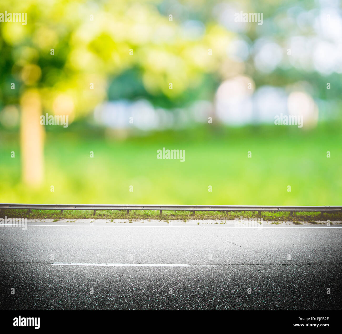 Green Forest Road Background Asphalt And Blurred Park Stock Photo Alamy
