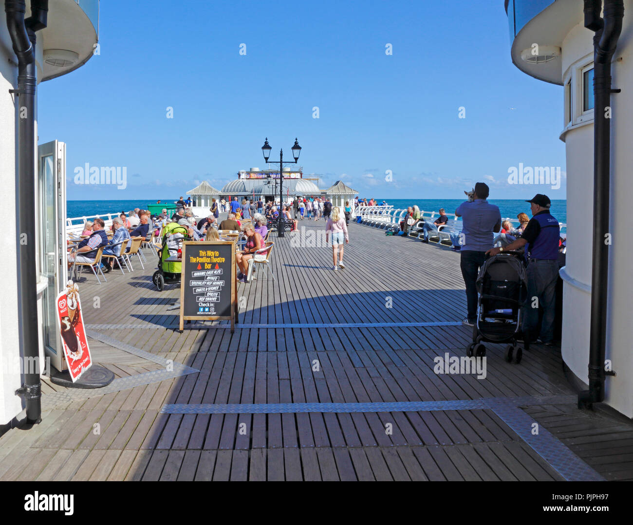 A view through the entrance onto the Pier at the North Norfolk seaside resort of Cromer, Norfolk, England, United Kingdom, Europe. - Stock Image