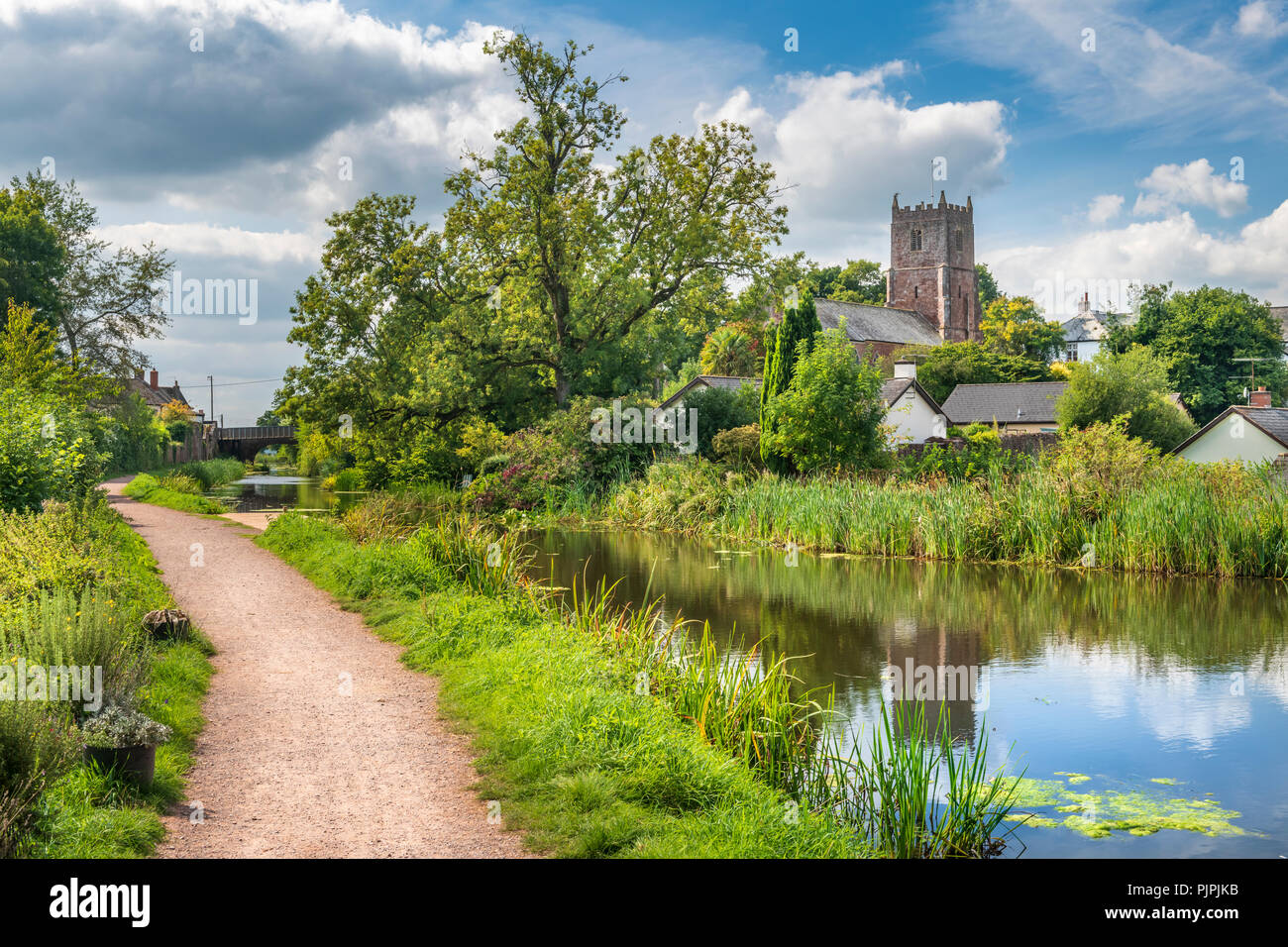 The Grand Western Canal runs through the middle of the picturesque Devon village of Sampford Peverell - Stock Image