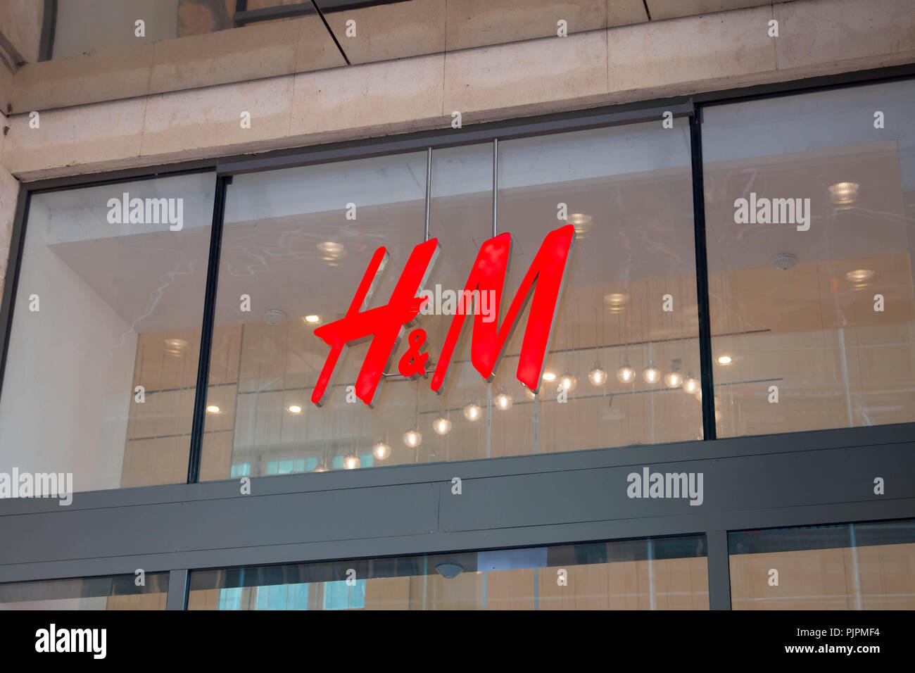 H&M front store clothes shopping logo h m - Stock Image