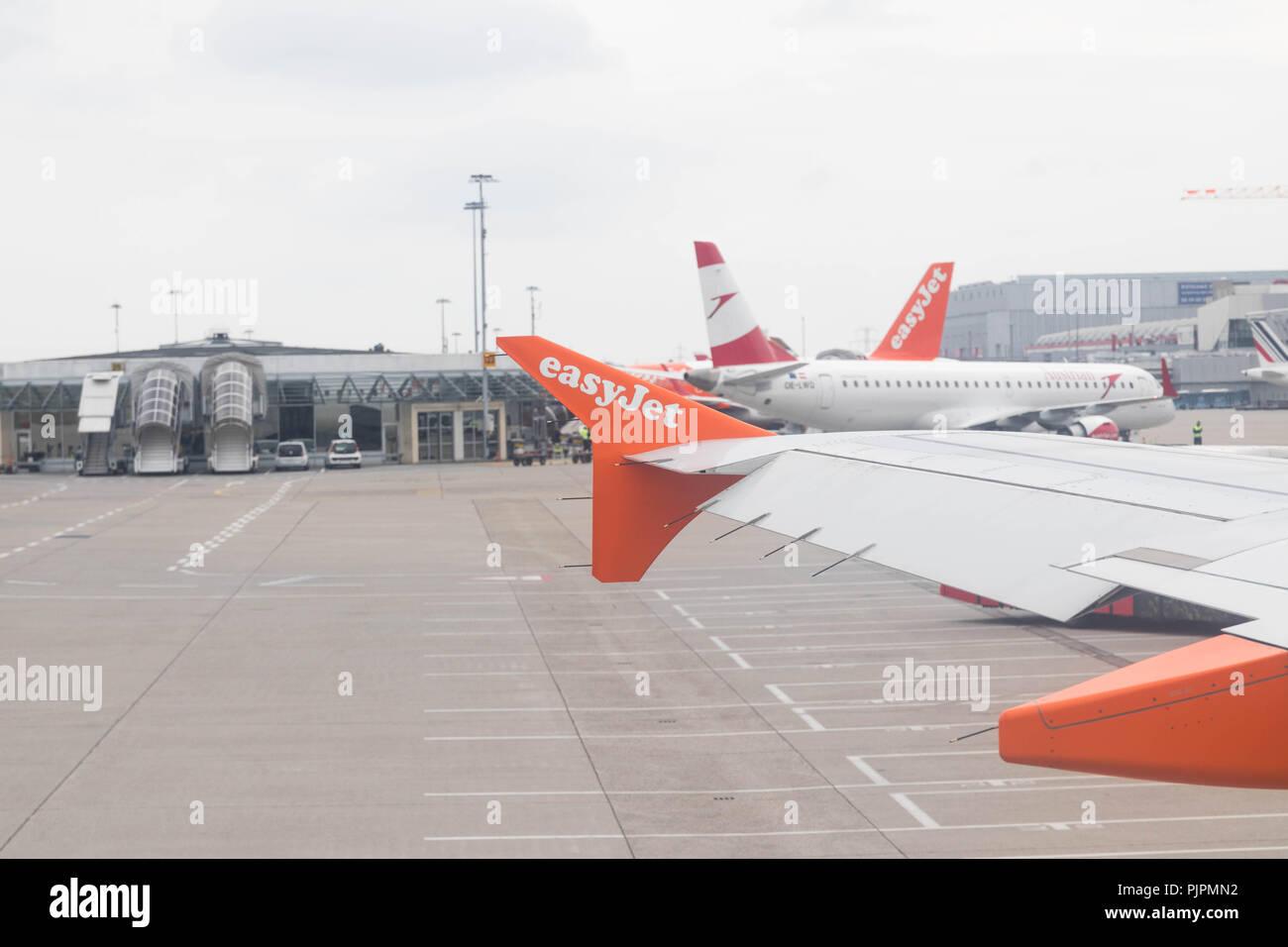 Easyjet airplane plane wings logo orange blue sky - Stock Image