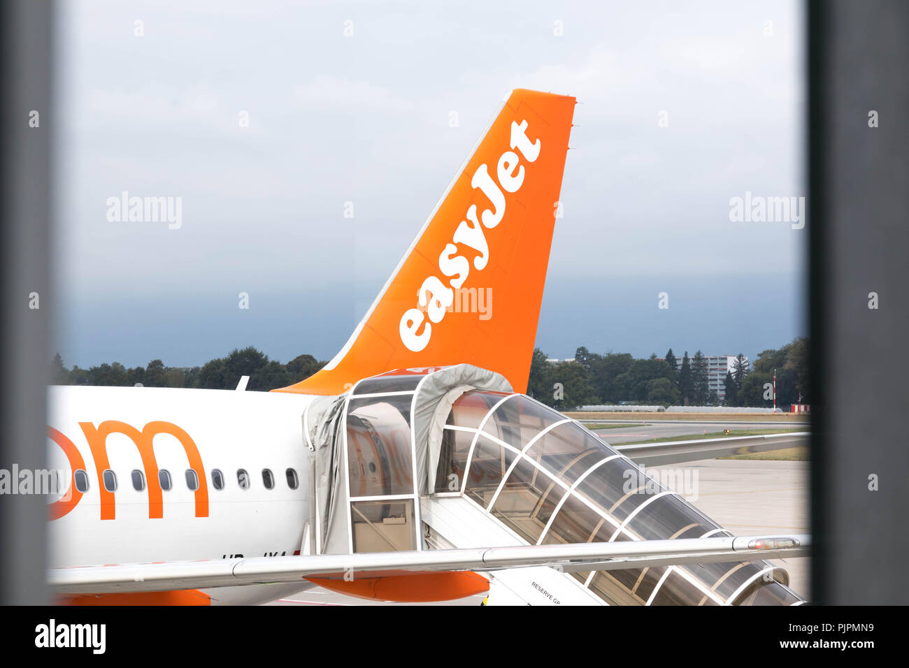 Plane of easyjet being boarding with staircase boarding - Stock Image