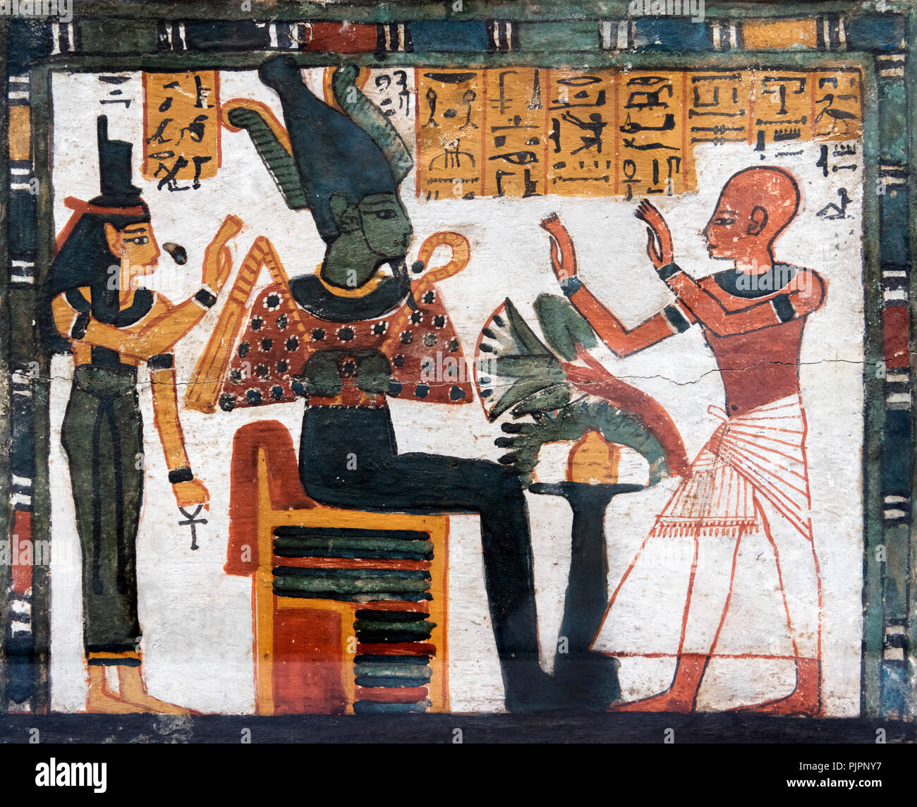 Egyptian painting, on a funerary box, representing Bakimen, scribe of the Treasury of Amun, worshipping Osiris and Isis. c.1296-1069 BC. - Stock Image