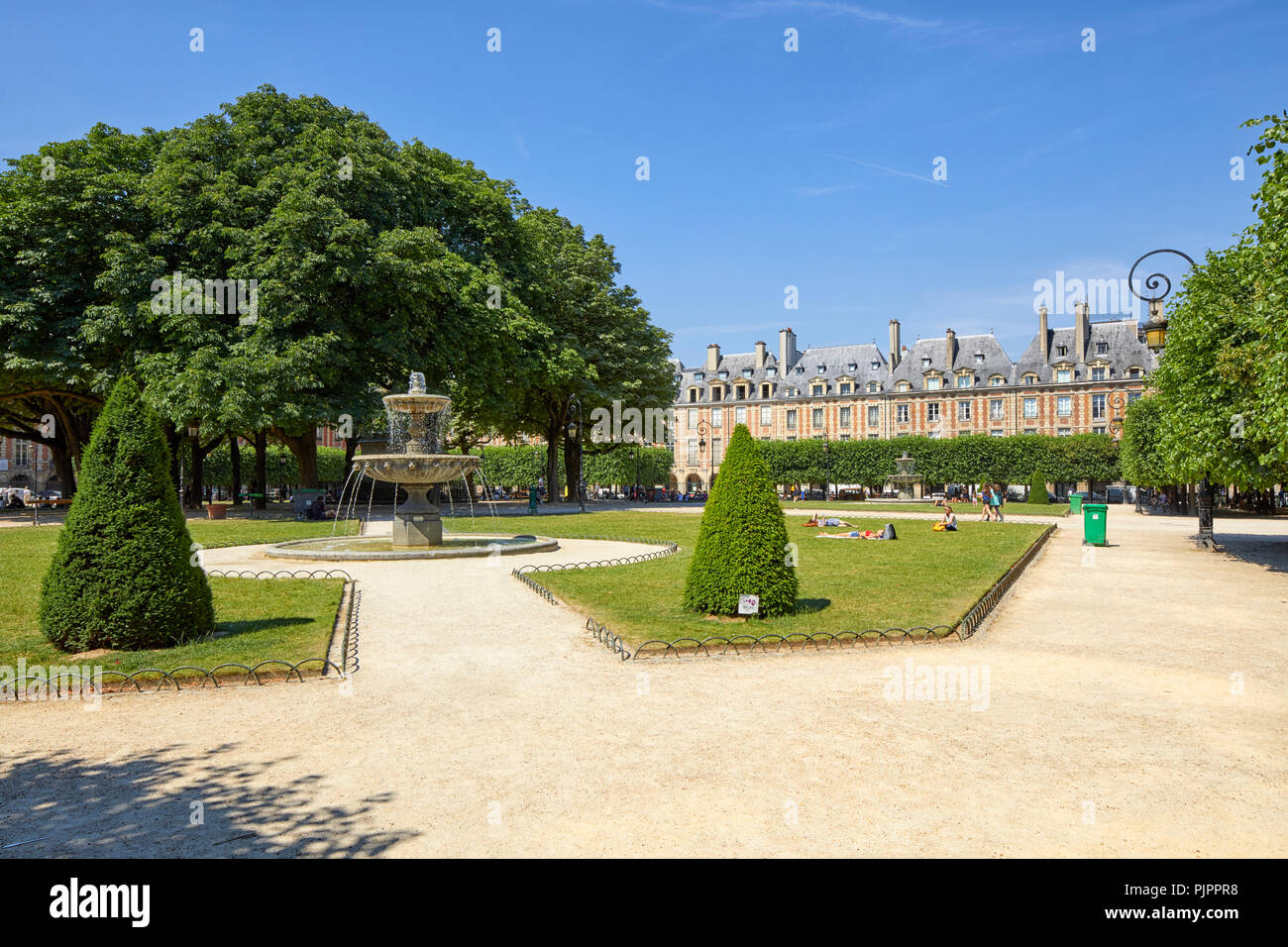 Northeastern Fountain by Jean-Pierre Cortot in Place des Vosges, Paris, France, Europe Stock Photo