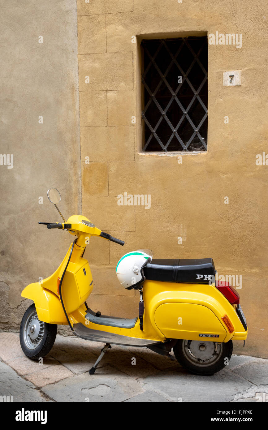 Yellow Vespa Piaggio A Traditional Italian Scooter Whith White Helmet Parked In A Street Of Pienza In Tuscany Stock Photo Alamy